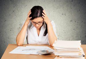 Woman doing taxes small 2 300x207 - Debt, Tax, Tax Form.