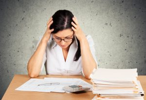 Woman doing taxes small 3 300x207 - Debt, Tax, Tax Form.